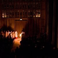 Choristers singing by candle light - College of St George