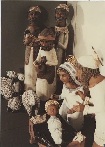 A group from the nativity scene. May and Joseph look over the baby Jesus and three shepherds stand by with their sheep.