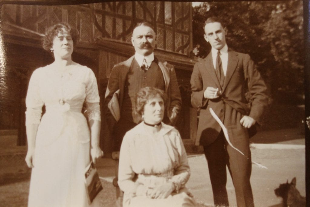 The Naylor family in the Horsehoe Cloister, including Eva and Fred Naylor, as well as their adult children, Kathleen and Alec.