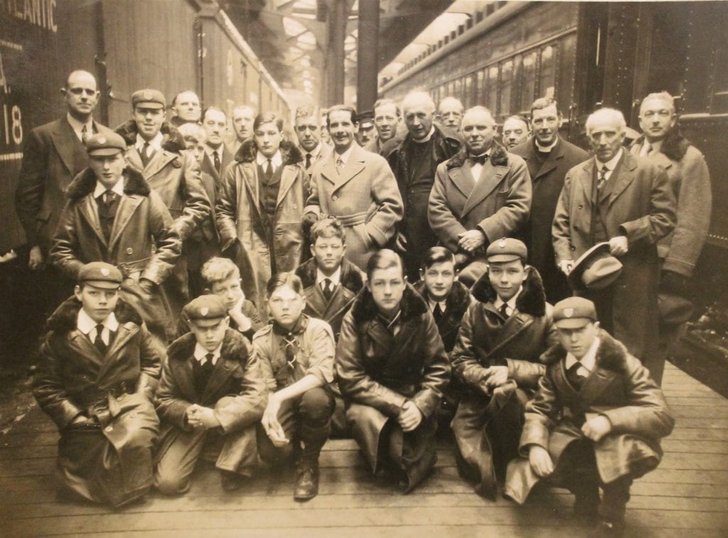 The gentlemen of St George's Chapel, Windsor and the choir boys of Westminster Abbey on a train platform in Canada, February 1927.