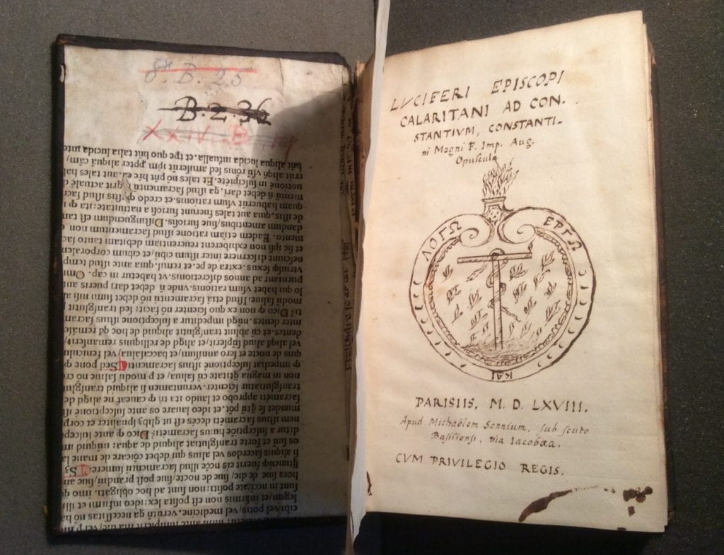 Photograph oPhotograph of a hand drawn title page, a highly accurate facsimile of the original print title page. Also visible are two manuscript fragments used in the binding of the book.f a hand drawn title page. Also visible are two manuscript fragments used in the binding of the book.