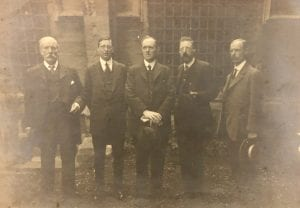Group portrait of W.H. Kendrick, Clerk of Works; W.A Miles, Junior Clerk of the Works; R.B. Robertson, Architect in Charge; W. Miles, Senior Clerk; A.F. Collins, ARIBA, August 1910. Endorsed with names [M.163/15/6]